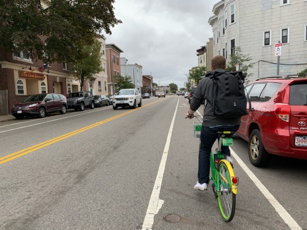 The author and his giant backpack biking through South Boston