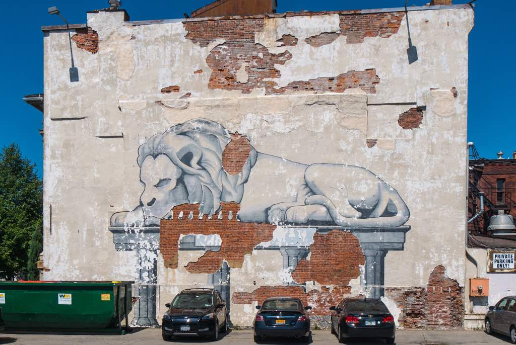 Decrepit lion mural at corner of Delaware Ave and Virginia St in Buffalo NY